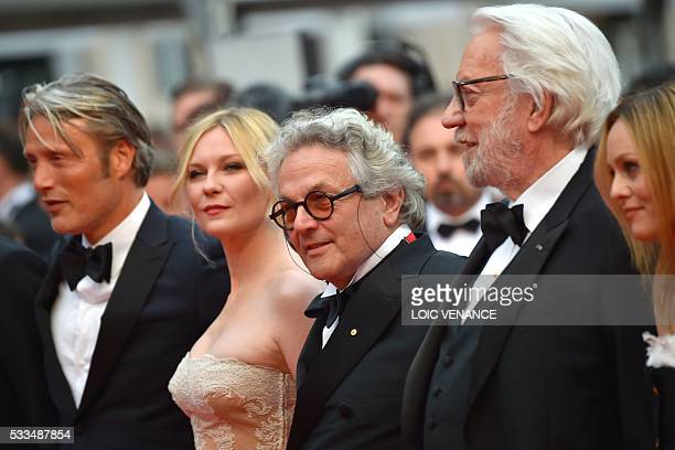 Australian director and President of the Jury George Miller poses with jury members Danish actor Mads Mikkelsen US actress Kirsten Dunst Canadian...