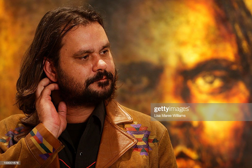 Australian director Warwick Thornton stands in front of a painting by artist Craig Ruddy after it being announced the winner of the Archibald People's Choice Prize at the Art Gallery Of NSW on May 20, 2010 in Sydney, Australia. The award, an additional category of the Archibald Prize, was voted by the viewing public and comes with a monetary prize of AUD