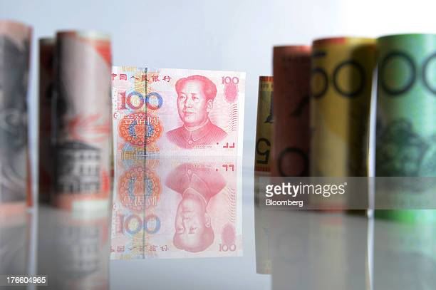Australian dollar banknotes of various denominations and a Chinese onehundred yuan banknote are arranged for a photograph in Melbourne Australia on...