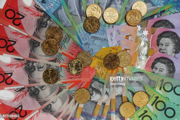 Australian dollar banknotes of various denominations and one dollar coins are arranged for a photograph in Sydney Australia on Friday Aug 4 2017 The...