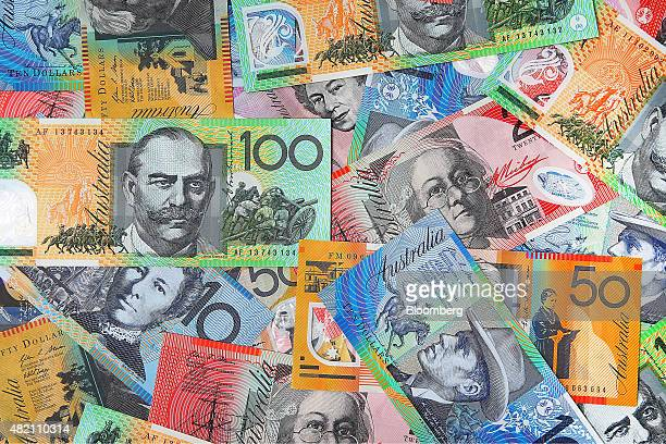 Australian dollar banknotes of various denominations are arranged for a photograph in Sydney Australia on Thursday July 24 2015 The Australian dollar...