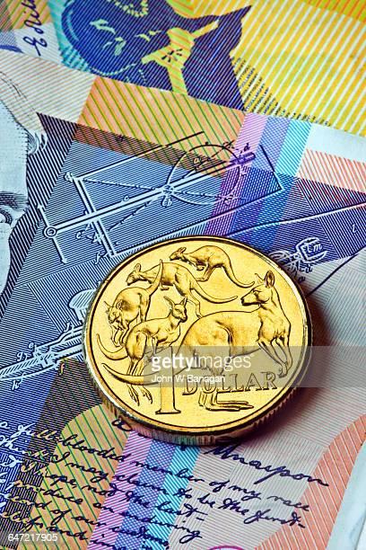 Australian Dollar coin on bank notes