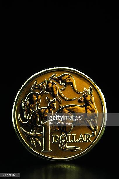 Australian Dollar coin on black background