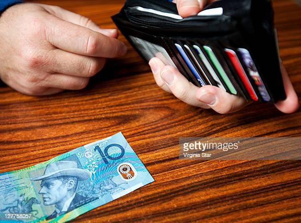 Australian dollars and mans wallet