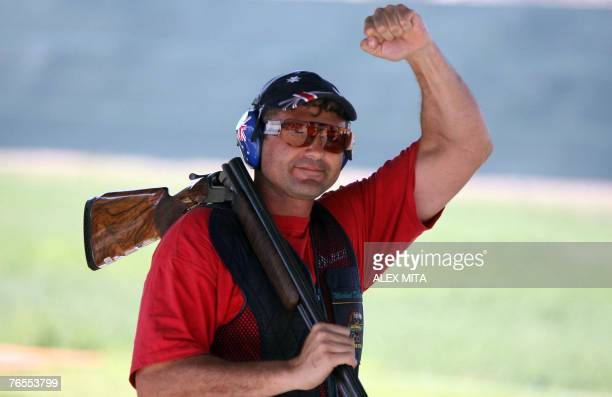 Australian double Olympic gold medalist Michael Diamond celebrates after achieving a final world record of 148 on his way to winning the trap event...