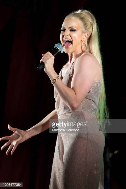 Australian drag queen Courtney Act performs during the Pride Cymru Big Weekend on August 26 2018 in Cardiff Wales Pride Cymru aims to eliminate...