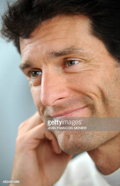 Australian driver Mark Webber smiles during a press conference before the qualifying session of the 82nd Le Mans 24 hours endurance race, on June 12,...