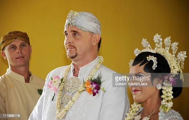 Australian drug smuggler Martin Eric Stephens stands next to his bride Winarni Puspayanti alias Christine as they listen to a priest during their...