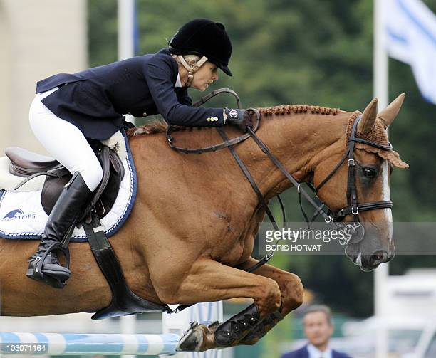 Australian Edwina Alexander jumps an obstacle on Cevo Itot du Chateau during the International Chantilly Show Jumping as part of the Global Champion...