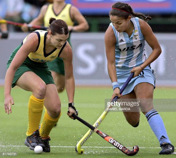 Australian Emily Halliday tries to stop Argentine Soledad Garcia during the bronze medal field hockey match for the Champions Trophy in Rosario...