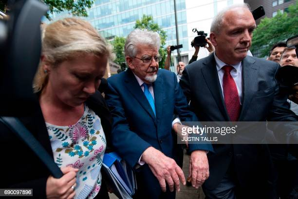 Australian entertainer Rolf Harris leaves Southwark Crown Court in London on May 30 2017 Harris had been accused of four counts of indecent assault...