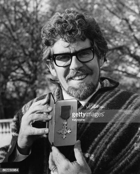 Australian entertainer Rolf Harris outside Buckingham Palace in London after receiving his OBE 22nd November 1977