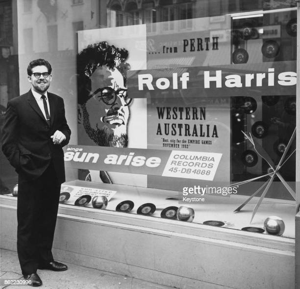 Australian entertainer Rolf Harris with a display of copies of his single 'Sun Arise' from Columbia Records 1962