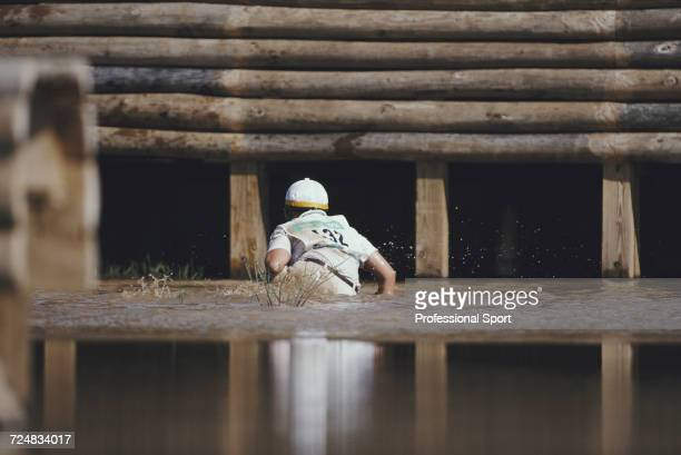 Australian equestrian Gillian Rolton pictured in water after falling from her horse Peppermint Grove at the water hazard in the Cross Country...