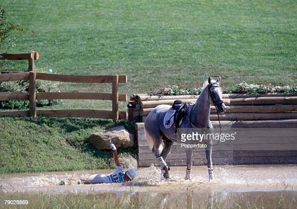 Australian equestrian rider Gillian Rolton pictured falling from her horse Peppermint Grove during the Cross Country discipline despite this setback...