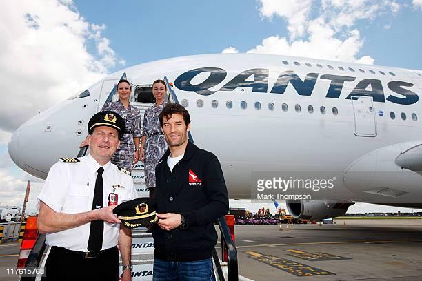 Australian F1 Driver Qantas Ambassador Mark Webber poses for photographs in front of a Qantas A380 alongside Captain Mark Penklis and cabin crew...