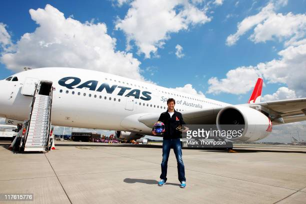 Australian F1 Driver Qantas Ambassador Mark Webber poses for photographs in front of a Qantas A380 during a media event to announce his future plans...