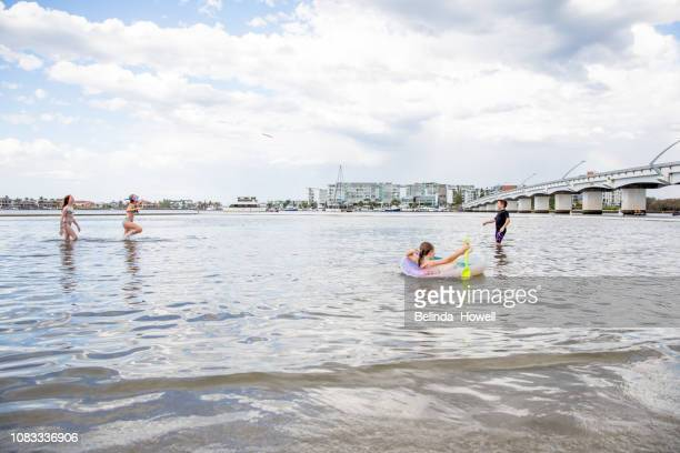 australian family enjoys the end of big day swimming in the ocean and dancing on their boat. - sea swimming stock pictures, royalty-free photos & images