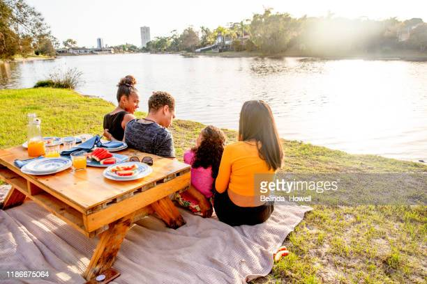 australian family in their backyard spend time together at sunrise - gold coast stock-fotos und bilder