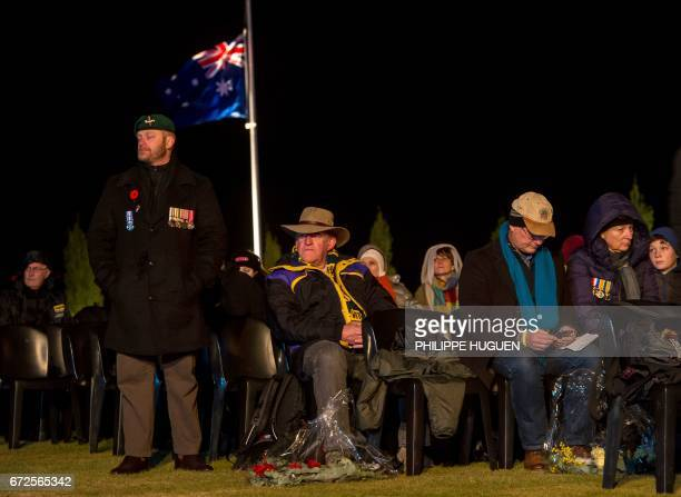 Australian family members wait for the Anzac Day ceremonies to start at the military cemetery of the Australian National Memorial in...