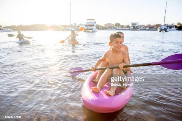 Australian family play along the Gold Coast water's edge