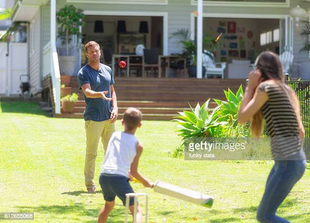 Australian family playing cricket