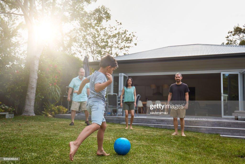 Australian family playing in the back yard garden : Stock Photo