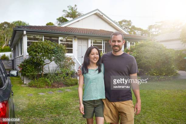australian family playing soccer in the back yard garden - heterosexual couple stock pictures, royalty-free photos & images