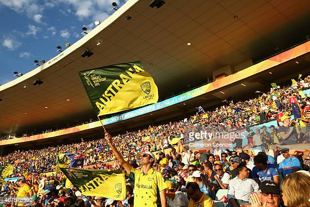 Australian fans celebrate a boundary during the 2015 Cricket World Cup Semi Final match between Australia and India at Sydney Cricket Ground on March...