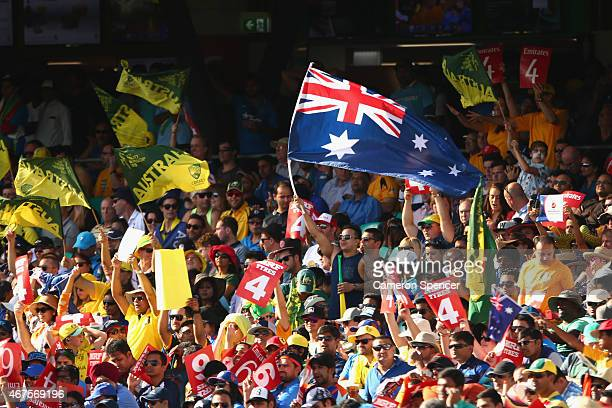 Australian fans celebrate a shot to the boundary during the 2015 Cricket World Cup Semi Final match between Australia and India at Sydney Cricket...