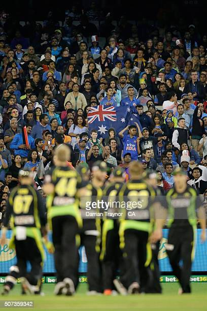 Australian fans cheer after the run out of Rohit Sharma of India during the International Twenty20 match between Australia and India at Melbourne...