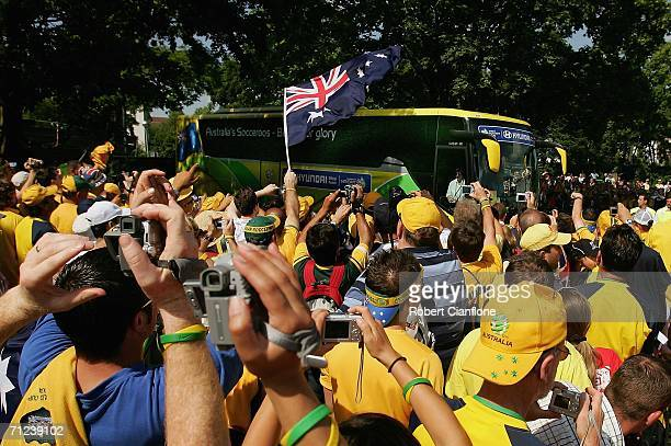 Australian fans cheer as the team bus arrives prior to the Australian training session at the OttoMeister Stadium June 19 2006 in Oehringen Germany