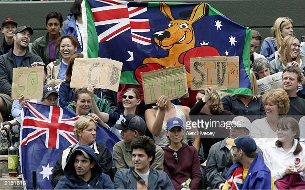 Australian fans cheer on Mark Philippoussis of Australia during his match against Alexander Popp of Germany in the men's quarter finals at the...