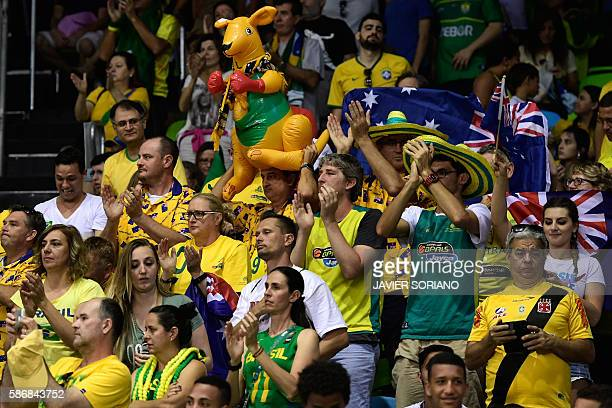 Australian fans cheer on their team during a Women's round Group A basketball match between Brazil and Australia at the Youth Arena in Rio de Janeiro...