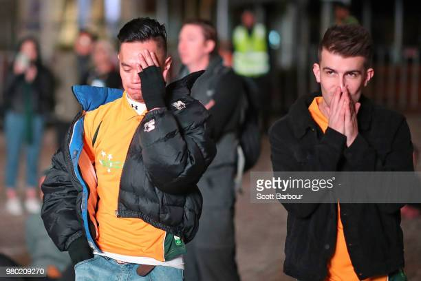 Australian fans react as Denmark score the first goal of the match as they watch the FIFA World Cup match between the Socceroos and Denmark on the...