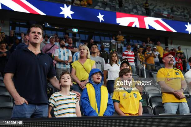 Australian fans sing the national anthem during the 2020 Tri-Nations match between the Australian Wallabies and the Argentina Pumas at Bankwest...