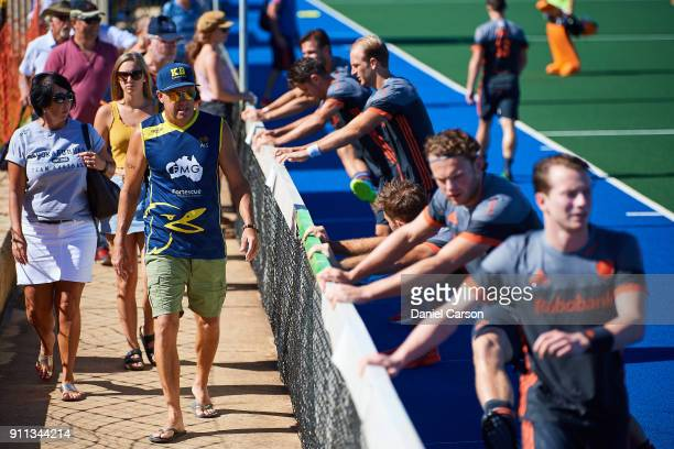 Australian fans walk past the Dutch as they warm up during the International Test match between the Australian Kookaburras and Netherlands at...