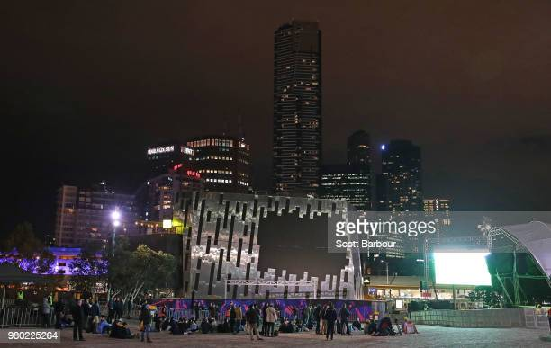 Australian fans watch the FIFA World Cup match between the Socceroos and Denmark on the big screen at Federation Square on June 21 2018 in Melbourne...