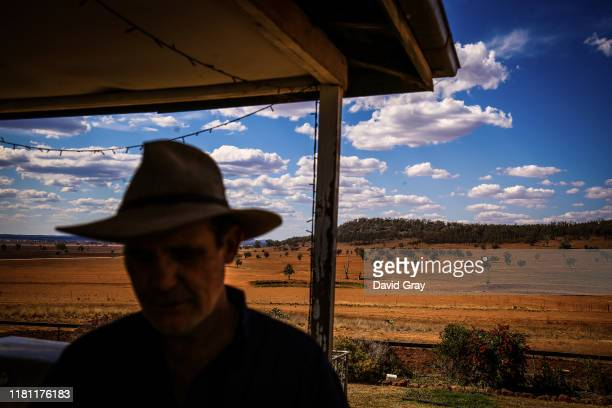 Australian farmer Ash Whitney stands on the verandah of his house on his drought-affected property located in the Goolhi area on the outskirts of the...