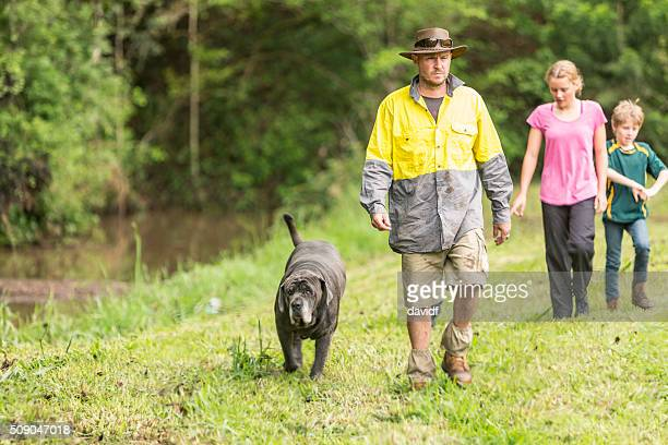 Australian Farmer Walking by a Creek With Dog and Children