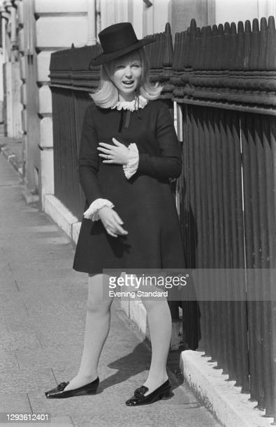 Australian fashion designer Prue Acton wearing an outfit reminiscent of early Quaker styles, UK, March 1967.