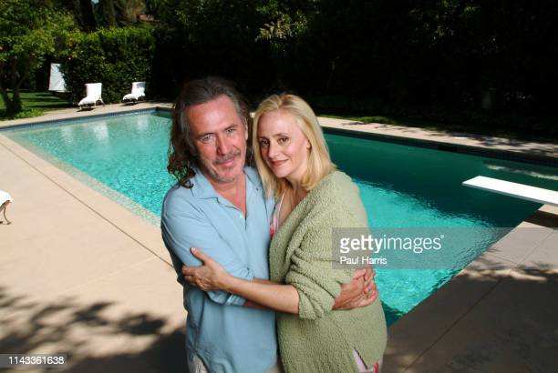 Australian fashion designer Richard Tyler with his business partner and wife Lisa Trafficante stand beside the pool of the large home they have lived...