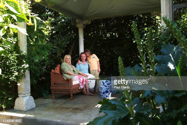 Australian fashion designer Richard Tyler with his business partner and wife Lisa Trafficante and 9 year old Son Edward sit on a terrace their large...