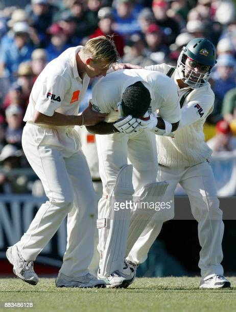 Australian fast bowler Brett Lee rushes in with Darren Lehmman to help England batsman Alex Tudor who he knocked down with a bouncer on day three of...