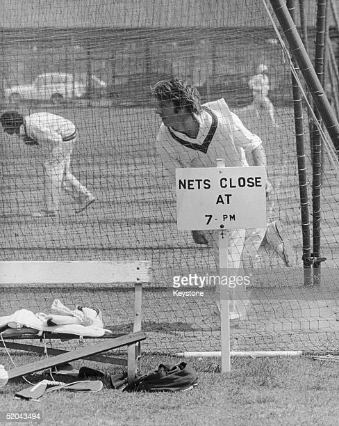 Australian fast bowler Jeff Thomson practises in the nets at Lords, in front of a sign which reads 'Nets Close at 7 pm', 10th June 1975.