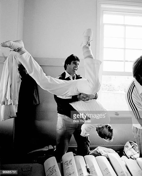 Australian fast bowler Len Pascoe holding batsman Ian Davis upside down during a lighthearted moment in the dressing at the County Ground in...