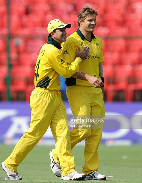 Australian fast bowler Shane Watson is congratulated by his captain Ricky Ponting after dimissing Canadian batsman Hiral Patel in the Cricket World...