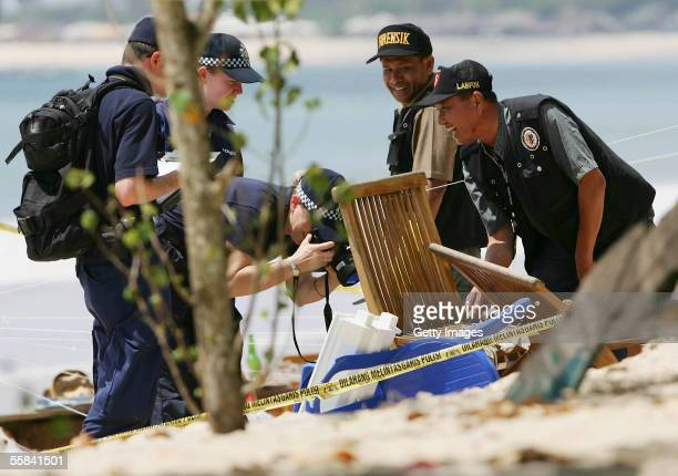 Australian Federal police and Indonesian Forensic collect evidence from the bomb site on Jimbaran beach after it was attacked by a suicide bomber...