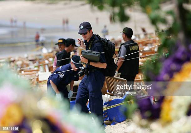 Australian Federal police collect evidence from the bomb site outside Fish Cafe on Jimbaran beach after it was attacked by a suicide bomber October 3...