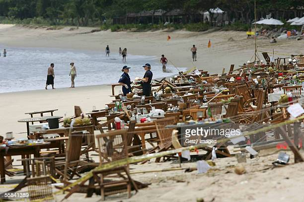 Australian Federal Police investigate the bomb site outside a Fish Cafe on Jimbaran beach after it was attacked by a suicide bomber October 3 2005 in...